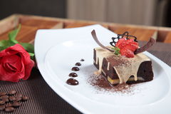 Delicious chocolate cake with creamy sauce Stock Photos