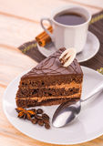 Delicious chocolate cake and cup of coffee Royalty Free Stock Image