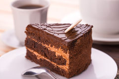 Delicious chocolate cake and cup of coffee Royalty Free Stock Photography