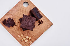 Delicious chocolate cake on cutting board, top view Royalty Free Stock Photography
