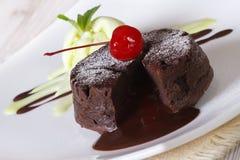 Delicious chocolate cake fondant close-up on a plate. horizontal. Delicious chocolate cake fondant with cherry closeup on a plate. horizontal stock photos