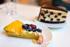Delicious chocolate cake and mango tart Royalty Free Stock Photography