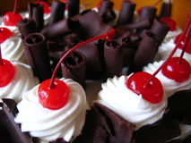 Delicious chocolate cake with maraschino cherries Royalty Free Stock Image