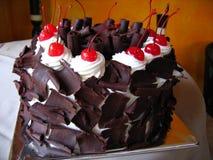 Delicious chocolate cake with maraschino cherries Royalty Free Stock Photos