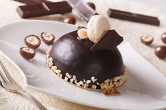 Delicious chocolate cake with nuts, topped with macaroon Stock Photo