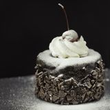 Delicious chocolate cake with red cherry royalty free stock photography