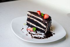 Delicious chocolate cake with strawberry on plate royalty free stock photos