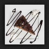 Delicious chocolate cake on white plate Royalty Free Stock Image