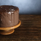 Delicious chocolate cake on the wooden surface. 3d render Royalty Free Stock Photography