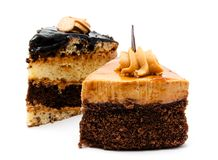 Delicious chocolate cakes pastry with peanut and cream isolated Royalty Free Stock Photos