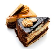 Delicious chocolate cakes pastry with peanut and cream isolated Stock Photos