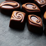 Delicious chocolate candies. Chocolates as background. Dark Chocolate Royalty Free Stock Photography