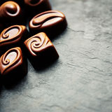 Delicious chocolate candies. Chocolates as background. Dark Chocolate Candy. Royalty Free Stock Photo