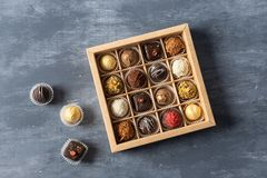 Delicious chocolate candies in gift box on table close-up, copy space royalty free stock photos