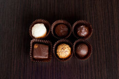 Delicious chocolate candies on wooden background. Close up, horizontal Royalty Free Stock Image