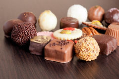 Delicious chocolate candies on wooden background. Horizontal Royalty Free Stock Photos