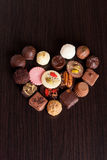 Delicious chocolate candies on wooden background. Vertical Royalty Free Stock Photos