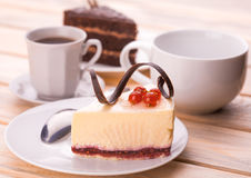 Delicious chocolate and cheesecake with cup of coffee Royalty Free Stock Images