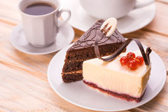 Delicious chocolate and cheesecake with cup of coffee Stock Images