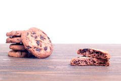 Delicious chocolate chip cookies on the board side view Stock Image