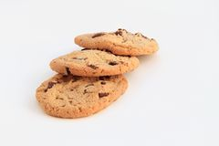 Delicious chocolate chip cookies on white backgrou Royalty Free Stock Images