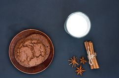 Delicious chocolate cookies. Milk in the glass. Sweet spices. Lie flat on a black background stock photos