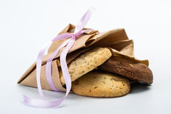 Delicious chocolate cookies. In a paper package tied with a beautiful pink ribbon Royalty Free Stock Photos
