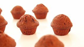 Delicious chocolate cupcakes, muffins on white background stock footage