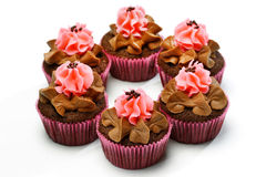 Delicious chocolate cupcakes with strawberry cream Royalty Free Stock Images