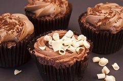 Delicious chocolate cupcakes with white chocolate curls Stock Photo