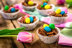 Delicious chocolate Easter sweets. On rustic background Stock Photos