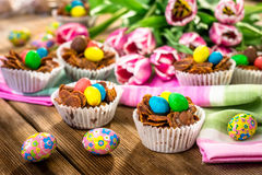 Delicious chocolate Easter sweets. On wooden background Royalty Free Stock Image