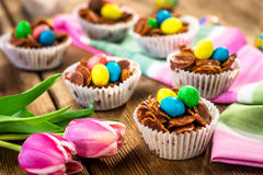Delicious chocolate Easter sweets. On wooden background Royalty Free Stock Images