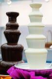 Delicious chocolate fondue fountains Royalty Free Stock Photo