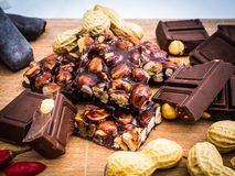 Delicious chocolate and Italian hazelnut nougat. Cut into pieces, for a sea of sweetness, in the background other nougats and chillies. Taken up close, with royalty free stock photo