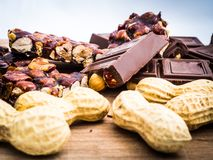Delicious chocolate and Italian hazelnut nougat, cut into pieces, for a sea of sweetness stock images