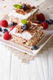 Delicious chocolate millefeuille with raspberry and blueberry cl. Ose-up on a plate. Vertical Royalty Free Stock Photo