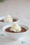 Delicious chocolate mousse. Small bowl of delicious chocolate mousse on christmas table cloth Stock Photo
