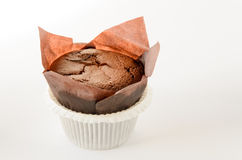 Delicious chocolate muffin on white background witch copy space Royalty Free Stock Photography