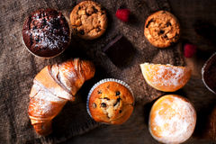 Delicious Chocolate muffins, croissants and dark chocolate piece Stock Photos