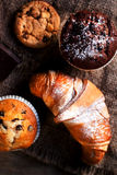 Delicious Chocolate muffins, croissants and dark chocolate piece Royalty Free Stock Photos