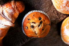 Delicious Chocolate muffins, croissants and dark chocolate piece Royalty Free Stock Photo