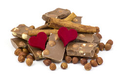 Delicious chocolate, nuts, cinnamon and hearts Stock Image