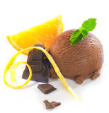 Delicious chocolate orange combo. With chocolate icecream and dark confectionery garnished with mint and fresh orange slices with zest Royalty Free Stock Image