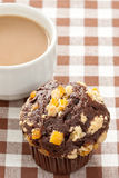 Delicious chocolate orange muffin and coffee cup Stock Photography