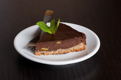 Delicious chocolate pie, with orange and a mint leaf for garnish. Close up Stock Images