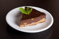 Delicious chocolate pie, with orange and a mint leaf for garnish Stock Photography