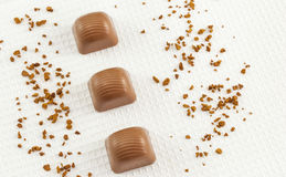 Delicious chocolate pralines on white background Royalty Free Stock Photo