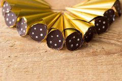 Delicious chocolate pralines wrapped in golden foil royalty free stock photos