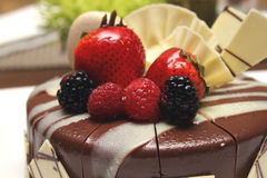 Delicious chocolate strawberry cake with chocolate ganache. Royalty Free Stock Photos